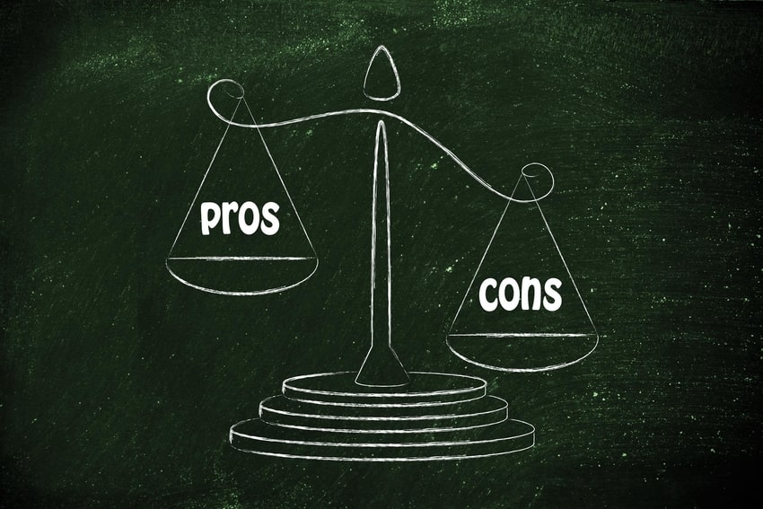 Scale weighing 'pros' and 'cons' with 'cons' outweighing 'pros'